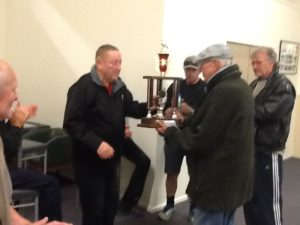 Mac Armstrong presents the ARPF Invercargill trophy to Kerry Frazer winner of the race 2014.