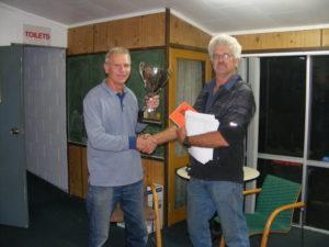 Theo Van Lier presents Tony Thum with ARPF OB Raumati trophy.