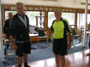 Theo Van Lier presents the ARPF Christchurch Old Bird trophy to Fred Van Lier